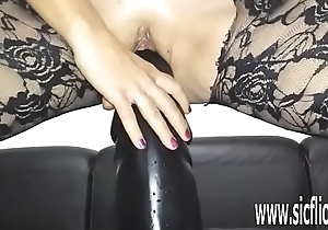 Sarah fucks her loose pussy with a tall dildo