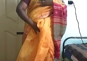 desi  indian horny tamil telugu kannada malayalam hindi cheating wife vanitha wearing orange colour saree  showing big boobs and shaved pussy press hard boobs press snack rubbing pussy masturbation