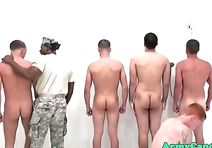 Military studs sucking cock in the shower
