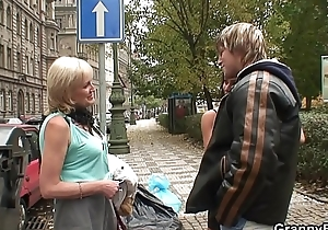 Young guy picks up 70 years old prostitute