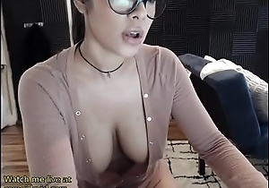 Busty brunette oils her huge tits - live at link