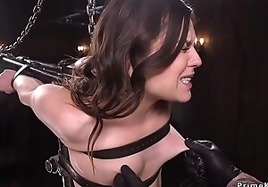 Babe in machine bondage caned in doggy