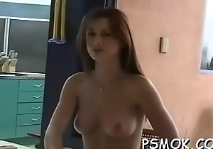 Horny babe smoking while giving a blowjob to her chap