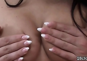Lovesome nympho is stretching narrow vulva in close-up and having orgasm