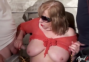 Fat mature whore enjoys blowing two dominating dicks
