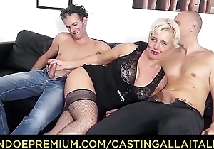CASTING ALLA ITALIANA - Mature Italian blonde gets DP and cum on feet up hot FFM threesome