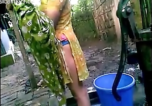 Pretty Young Bangladeshi Deshi Girl with Big Boobs Films Herself Bathing Outdoor Butt Naked